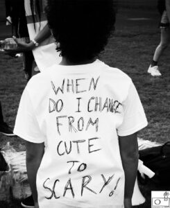 A person wearing a T-shirt with the text: When do I change from Cute to Scary